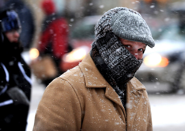 """Ronnell Roegner of Hot Springs, Arkansas, is dressed for the weather as he crosses Broadway on Thursday.<br /> For more photos and a video of the storm, go to  <a href=""""http://www.dailycamera.com"""">http://www.dailycamera.com</a>.<br /> Cliff Grassmick / December 30, 2010"""
