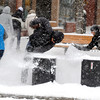 "Adrianna Baraco, left, and Nina Duerst. right, surround a friend during a snow ball fight along the Pearl Street Mall on Thursday.<br /> For more photos and a video of the storm, go to  <a href=""http://www.dailycamera.com"">http://www.dailycamera.com</a>.<br /> Cliff Grassmick / December 30, 2010"