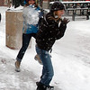 "Adrianna Baraco, left, throws snow at Nina Duerst, along the Pearl Street Mall on Thursday.<br /> For more photos and a video of the storm, go to  <a href=""http://www.dailycamera.com"">http://www.dailycamera.com</a>.<br /> Cliff Grassmick / December 30, 2010"