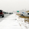 A FedEx van waits for a tow truck on Highway 287 just south of Broomfield after sliding off the road during a snowstorm on Thursday, Dec. 30.<br /> Jeremy Papasso/Camera