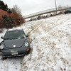 A vehicle sits off Route 287 in Lafayette Thursday morning.<br /> Photo by Paul Aiken / December 30 2010