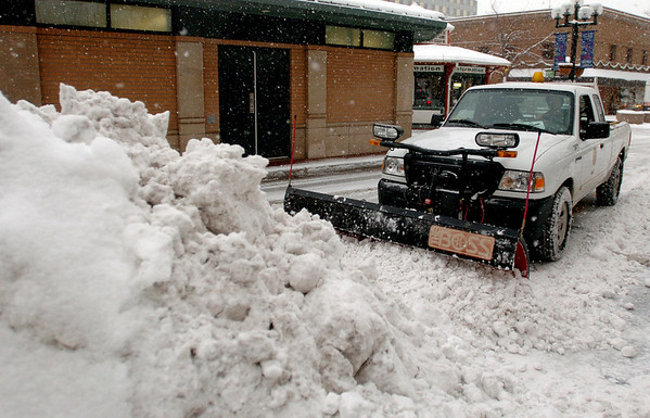 """Lance Rouse of the City of Boulder, plows snow along the Pearl Street Mall.<br /> For more photos and a video of the storm, go to  <a href=""""http://www.dailycamera.com"""">http://www.dailycamera.com</a>.<br /> Cliff Grassmick / December 30, 2010"""