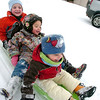 From left Taytem Kowalchuk, 4, Ruby Janet Tanaka, 3, and Boone Kowalchuk, 2, get pulled by dad Illya Kowalchuk on a snowy Thursday morning in Lafayette.<br /> Photo by Paul Aiken / December 30 2010