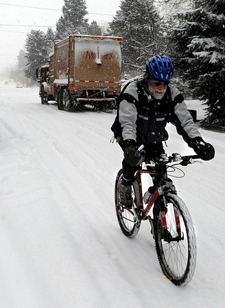 Rich Rotunno, 61, of Boulder, rides his bicycle to his home on University Hill during a snowstorm on Thursday, Dec. 30.<br /> Jeremy Papasso/Camera