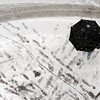 """A pedestrian crosses 14th Street along Walnut in Boulder through the Thursday snow.<br /> For more photos and a video of the storm, go to  <a href=""""http://www.dailycamera.com"""">http://www.dailycamera.com</a>.<br /> Cliff Grassmick / December 30, 2010"""