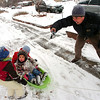David Tanaka takes photos of from left Boone Kowalchuk, 2, Ruby Janet Tanaka, 3 and Taytem Kowalchuk, 4, as they play in the snow on a snowy Thursday morning in Lafayette.<br /> Photo by Paul Aiken / December 30 2010
