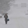 KRISTOPHER RADDER - BRATTLEBORO REFORMER<br /> Tanya Horrigan, of Brattleboro, Vt., tries to remain dry while walking down Western Avenue in Brattleboro during Winter Storm Stella on Tuesday, March 14, 2017.