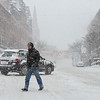 KRISTOPHER RADDER - BRATTLEBORO REFORMER<br /> Colin Grube crosses Main Street in Brattleboro, Vt., while wind whips snow around during Winter Storm Stella on Tuesday, March 14, 2017.