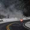 KRISTOPHER RADDER - BRATTLEBORO REFORMER<br /> A downed power line on Route 100, in East Jamaica, shoots out flames from a live powerline exposed to the elements on Friday, March 2, 2018. The road was closed down to allow crews from Green Mountain Power to repair the line.