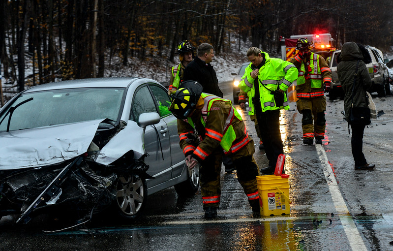 KRISTOPHER RADDER - BRATTLEBORO REFORMER<br /> Crews from the Spofford Fire Department clean up after a head-on, two-motor-vehicle collision on Route 9, closeD down the eastbound lane around 3:50 p.m. on Friday. Minor injuries were reported on scene. The driver of a Honda Civic traveling in the Westbound lane lost control and slid into oncoming traffic. The cause of the incident is under investigation. The was the second crash in a one-hour span on Route 9, happening a quarter-of-a-mile from each other.
