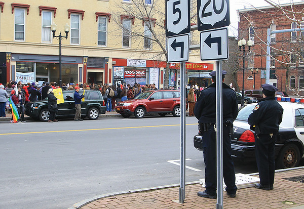 Spencer Tulis/Finger Lakes Times City police kept a mindful eye on activities Wednesday from across Exchange Street.