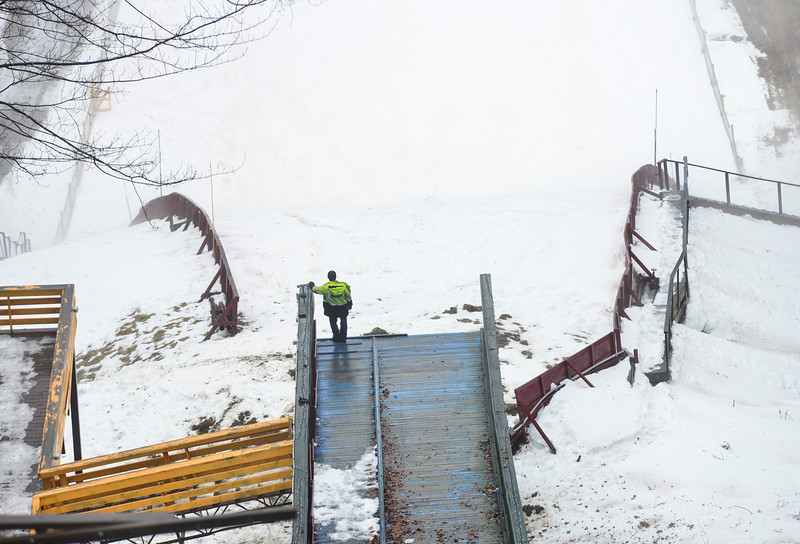 KRISTOPHER RADDER - BRATTLEBORO REFORMER<br /> Ryan Jones, of Evans Construction, looks over the fog at the bottom of the inrun at the Harris Hill Ski Jump on Friday, Jan. 12, 2018 as they prepare the annual ski jump competition.