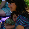 KRISTOPHER RADDER — BRATTLEBORO REFORMER<br /> Robin Morgan, of Brattleboro, smiles while holding her 2-year-old daughter, Maude Martyn during the 10th annual Global Big Latch On outside of the Centre Congregational Church, in Brattleboro, as part of World Breastfeeding Week on Friday, Aug. 2, 2019.