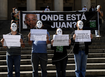 "People protest against the disappearance of Juan de Moraes, 11, a boy wounded during a gunfire between police and drug traffickers in the Danon slum, Rio de Janeiro, Brazil, June 29, 2011. Parents and human rights militants accuse the police for the disappearance. In the big banner says: ""Where is Juan?"". (Austral Foto/Renzo Gostoli)"