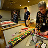 KRISTOPHER RADDER — BRATTLEBORO REFORMER<br /> Members of the Brattleboro Rotary Club wrap nearly 350 gifts on Thursday, Dec. 6, 2018, that will be handed to people at Pine Heights, Vernon Green, Thompson House, Holton Home, and Bradly House.