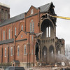 Demolition continues on the St. Patrick's Church in Watervliet now that the cross on the rear of the church has been removed.  (Mike McMahon / The Record)