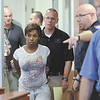 Audrea Gause 26, of Troy, N.Y., is lead into Troy Police Court Friday July 19, 2013 being arraigned on a Massachusetts fugitive warrant in Troy, N.Y.. (J.S.Carras/The Record)