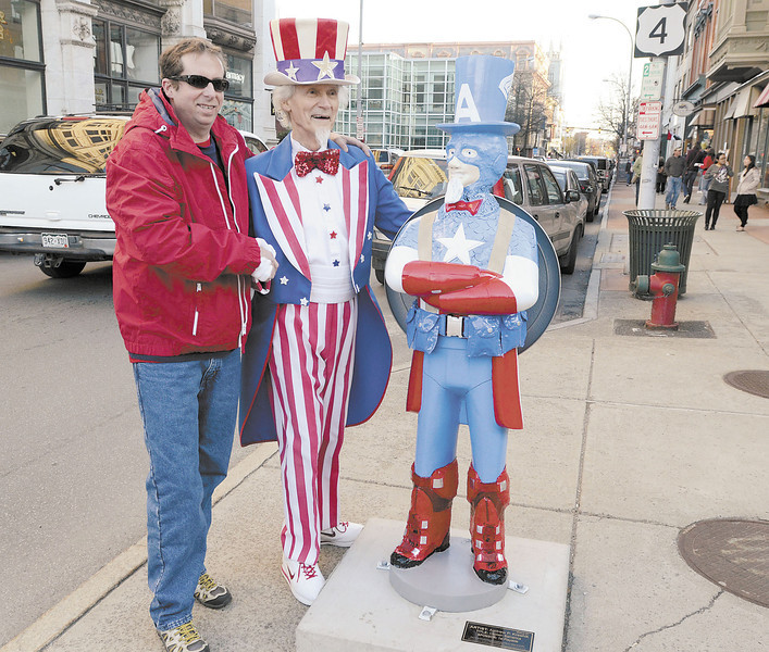 David Rivage of Brunswick poses with Fred Polnisch as Uncle Sam and Captain Samerica on Third Street at The Uncle Sam Project during Troy Night Out Friday, April 26, 2013 in Troy.  (J.S.Carras/The Record)