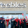 J.S.CARRAS/THE RECORD  Local politicians, plaza owners and store staff cut ribbon during the Peebles Department Store grand opening Thursday, November 14, 2013 in Troy Plaza on Hoosick Street in Troy, N.Y..