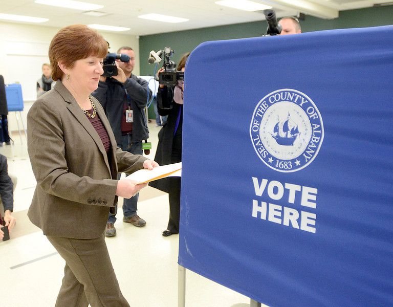 J.S.CARRAS/THE RECORD  Albany mayoral candidate Kathy Sheehan prepares to cast her ballot at Mater Christi Parish Center Tuesday, November 5, 2013 in Albany, N.Y..
