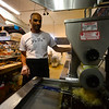 KRISTOPHER RADDER - BRATTLEBORO REFORMER<br /> Zohar Arama, the owner of Yalla Vermont, makes a falafel sandwich with eggplant during their first day of business on Tuesday, May 1, 2018.