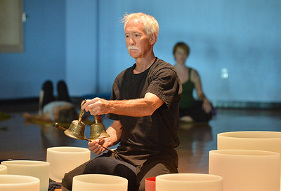Keith Montoya plays the Tibetan singing bowls during the Yoga and Tibetan singing bowls fundraiser for the family of Aurora theater shooting victims Ashely Moser and her daughter who died, Veronica, 6, at the Paul Derda Recreation Center on Sunday.  August 12, 2012 staff photo/ David R. Jennings