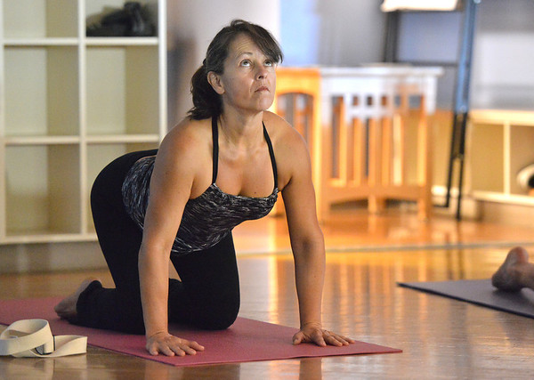 Patty Beecroft strikes a pose during the Yoga and Tibetan singing bowls fundraiser for the family of Aurora theater shooting victims Ashely Moser and her daughter who died, Veronica, 6, at the Paul Derda Recreation Center on Sunday.August 12, 2012<br /> staff photo/ David R. Jennings