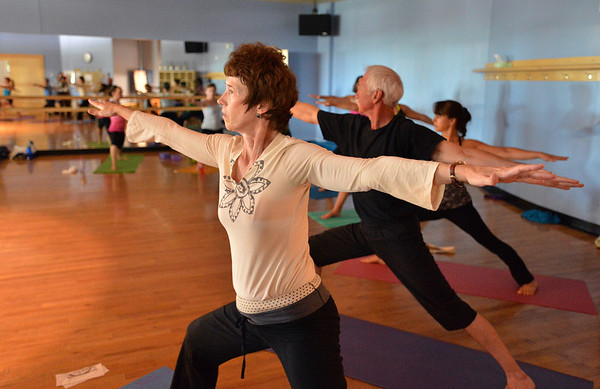 Organizer Vicki Ferguson strikes a pose during the Yoga and Tibetan singing bowls fundraiser for the family of Aurora theater shooting victims Ashely Moser and her daughter who died, Veronica, 6, at the Paul Derda Recreation Center on Sunday.August 12, 2012<br /> staff photo/ David R. Jennings