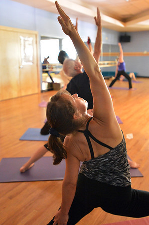 Patty Beecroft strikes a pose during the Yoga and Tibetan singing bowlsfundraiser for the family of Aurora theater shooting victims Ashely Moser and her daughter who died, Veronica, 6, at the Paul Derda Recreation Center on Sunday.<br /> August 12, 2012<br /> staff photo/ David R. Jennings