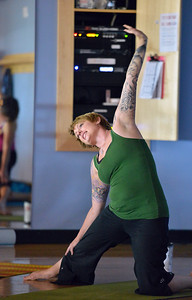 Instructor Shannon Faber strikes a pose during the Yoga and Tibetan singing bowls fundraiser for the family of Aurora theater shooting victims Ashely Moser and her daughter who died, Veronica, 6, at the Paul Derda Recreation Center on Sunday. August 12, 2012 staff photo/ David R. Jennings