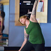 Instructor Shannon Faber strikes a pose during the Yoga and Tibetan singing bowls fundraiser for the family of Aurora theater shooting victims Ashely Moser and her daughter who died, Veronica, 6, at the Paul Derda Recreation Center on Sunday.<br /> August 12, 2012<br /> staff photo/ David R. Jennings