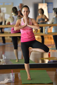 Robyn Divirgilio in a yoga pose during the Yoga and Tibetan sining bowls fundraiser for the family of Aurora theater shooting victims Ashely Moser and her daughter who died, Veronica, 6, at the Paul Derda Recreation Center on Sunday.  August 12, 2012 staff photo/ David R. Jennings