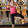 Robyn Divirgilio in a yoga pose during the Yoga and Tibetan sining bowls fundraiser for the family of Aurora theater shooting victims Ashely Moser and her daughter who died, Veronica, 6, at the Paul Derda Recreation Center on Sunday. <br /> August 12, 2012<br /> staff photo/ David R. Jennings