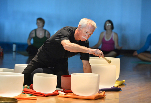 Keith Montoya plays the Tibetan singing bowls during the Yoga and Tibetan singing bowls fundraiser for the family of Aurora theater shooting victims Ashely Moser and her daughter who died, Veronica, 6, at the Paul Derda Recreation Center on Sunday. <br /> August 12, 2012<br /> staff photo/ David R. Jennings
