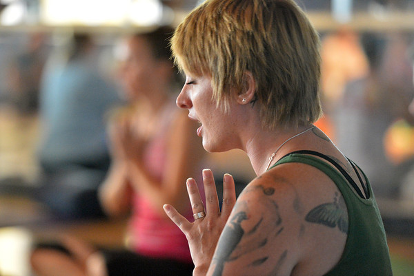 Instructor Shannon Faber leads  the Yoga and Tibetan singing bowls fundraiser for the family of Aurora theater shooting victims Ashely Moser and her daughter who died, Veronica, 6, at the Paul Derda Recreation Center on Sunday.August 12, 2012<br /> staff photo/ David R. Jennings