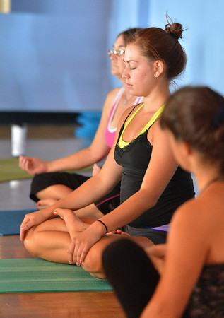 Hannah Price, 17,  strikes a pose during the Yoga and Tibetan singing bowls fundraiser for the family of Aurora theater shooting victims Ashely Moser and her daughter who died, Veronica, 6, at the Paul Derda Recreation Center on Sunday.<br />  August 12, 2012<br /> staff photo/ David R. Jennings