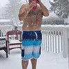 """My crazy husband making the most of his snow day."" Submitted by Lisa Ostellino."