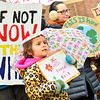 KRISTOPHER RADDER — BRATTLEBORO REFORMER<br /> Jubilee Anthes, 6, a first-grader at Oak Grove Elementary School, in Brattleboro, joins students as part of a global climate strike before the start of classes on Friday, March 15, 2019.