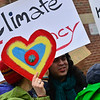 """KRISTOPHER RADDER — BRATTLEBORO REFORMER<br /> A group of students and parents gather outside the Brattleboro Union High School before the start of classes to join a global movement """"Youth Climate Action"""" on Friday, March 15, 2019."""