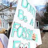 "ELODIE REED - FOR THE BERKSHIRE EAGLE Williams College junior Chloe Henderson holds her sign, ""Don't be a Fossil Fool,"" during the Youth Climate Strike and Rally in Williamstown on Friday."