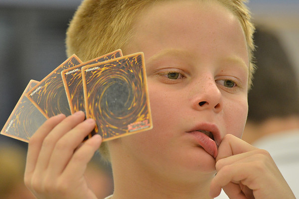 Kevin Peacock, 10, holds his cards while contemplating his next move during the Yu-Gi-Ho! tournament at the Mamie Doud Eisenhower Public Library on Friday.<br /> August 10, 2012<br /> staff photo/ David R. Jennings