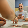 Mike Carroll, 43, plays Tomas Cabrera, 15, in the advanced play during the Yu-Gi-Ho! tournament at the Mamie Doud Eisenhower Public Library on Friday. <br /> August 10, 2012<br /> staff photo/ David R. Jennings
