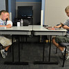 Brady Giles, 10, left, yawns while playing Ethan Cranston, 11,  during the Yu-Gi-Ho! tournament at the Mamie Doud Eisenhower Public Library on Friday.<br /> August 10, 2012<br /> staff photo/ David R. Jennings