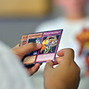 A player sutdies his cards during the Yu-Gi-Ho! tournament at the Mamie Doud Eisenhower Public Library on Friday.<br /> August 10, 2012<br /> staff photo/ David R. Jennings