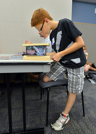 Imran Islam, 11, adds up points during the Yu-Gi-Ho! tournament at the Mamie Doud Eisenhower Public Library on Friday.<br /> August 10, 2012<br /> staff photo/ David R. Jennings