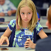 Sydney Partrick, 11, playing Imran Islam, 11,  during the Yu-Gi-Ho! tournament at the Mamie Doud Eisenhower Public Library on Friday.<br /> August 10, 2012<br /> staff photo/ David R. Jennings