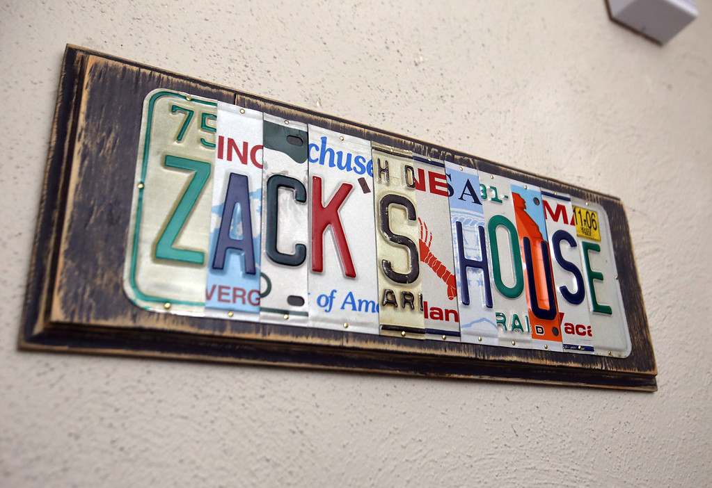 . Zack\'s House at 221 Pawtucket Blvd, a partnership between Zack\'s Team Foundation and Lowell House, will open this week as a \'sober house\' for 18-26-year-old men recovering from addiction. The Zack\'s House sign was custom made with license plates from New England. (SUN/Julia Malakie)