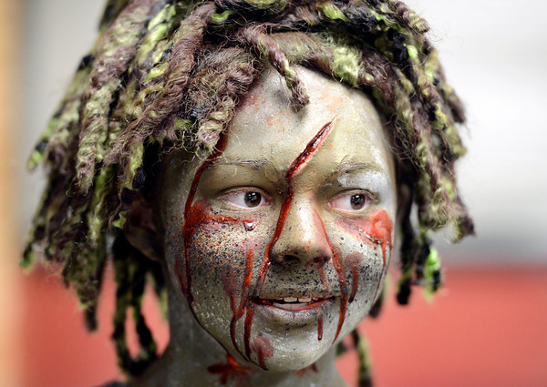 """Fairview High School freshman Sydney McViker in costume during a zombie invasion on Tuesday, Feb. 19, at Fairview High School in Boulder. The event was part of a video to bring awareness to problems such as substance abuse, cutting, stress, depression and eating disorders. For more photos and video of the zombie invasion at Fairview High School go to  <a href=""""http://www.dailycamera.com"""">http://www.dailycamera.com</a><br /> Jeremy Papasso/ Camera"""