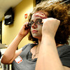 "Centaurus High School freshman Liliana Benzel puts on her glasses after applying fake blood to them during the filming of an Awareness Drive week zombie video on Tuesday, Feb. 19, at Fairview High School in Boulder. The event was part of a video to bring awareness to problems such as substance abuse, cutting, stress, depression and eating disorders. For more photos and video of the zombie invasion at Fairview High School go to  <a href=""http://www.dailycamera.com"">http://www.dailycamera.com</a> DAILY CAMERA/ JESSICA CUNEO."