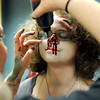 "Theatrical Costumes Ect. employee Danica Minor applies fake blood to the face of Centaurus High School freshman Liliana Benzel during the filming of an Awareness Drive week zombie video on Tuesday, Feb. 19, at Fairview High School in Boulder. The event was part of a video to bring awareness to problems such as substance abuse, cutting, stress, depression and eating disorders. For more photos and video of the zombie invasion at Fairview High School go to  <a href=""http://www.dailycamera.com"">http://www.dailycamera.com</a><br /> Jeremy Papasso/ Camera"